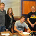 Matthew Morris, seated signs with Seattle University, with parents Bob and Kay Morris and LHS swim coach Andy Stewart.
