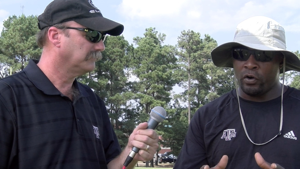 Ricky Gay, left, interviews Coach Alton Dixon during the Panthers preseason startup in August 2015. (Photo: Misty Boggs| MSGPR)