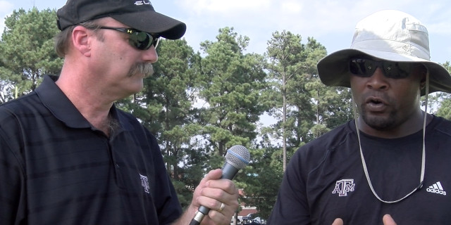 Ricky Gay, left, interviews Coach Alton Dixon during the Panthers preseason startup in August 2015. (Photo: Misty Boggs  MSGPR)