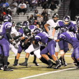 The Panthers defensive line holds the Lobos from a late 3rd quarter rally. The Panthers would eventually win the game, 35-24. (Photo: Misty Boggs)
